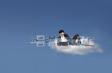 Businessman on cloud using internet