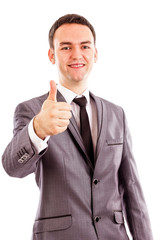 Happy smiling young business man with thumb up gesture