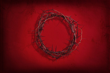 Crown of thorns on red grunge background