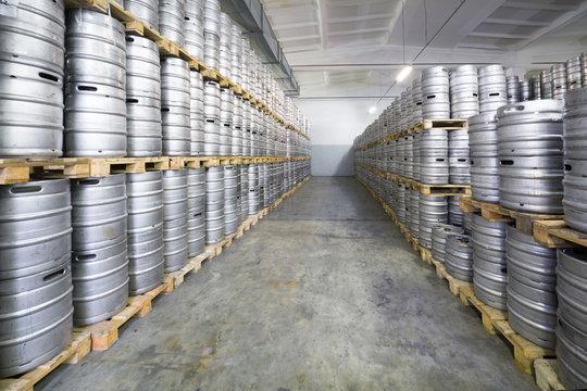 Rows of beer kegs in stock brewery