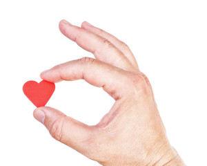 Man's hand holding a human heart. Symbol of health and love.
