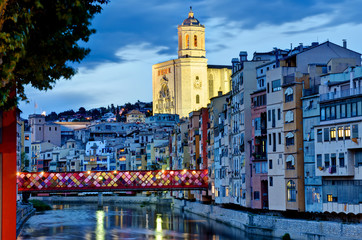 Girona by night with cathedral and decorated bridge