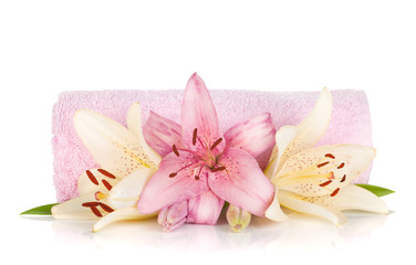 Spa setting with colorful lily flowers