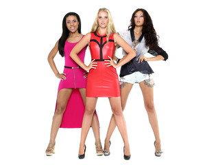 Three young beautiful models in a full length
