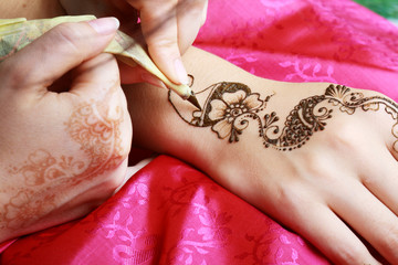 henna being applied to hand