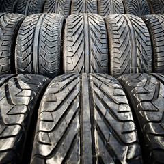 Used old car tires detail pattern, background or texture