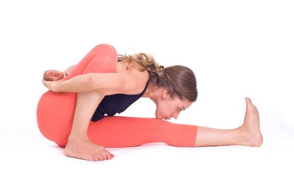 Practicing Yoga exercises / Ray of Light Pose - Marichyasana