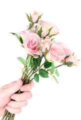 Man's hand giving a roses isolated on white
