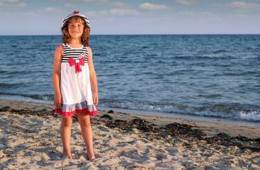 Wall Mural - beautiful little girl on beach