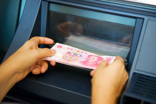 Chinese yuan issuing by ATM on hand