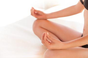 Yoga woman. Closeup of Young woman meditating in pose of lotus.