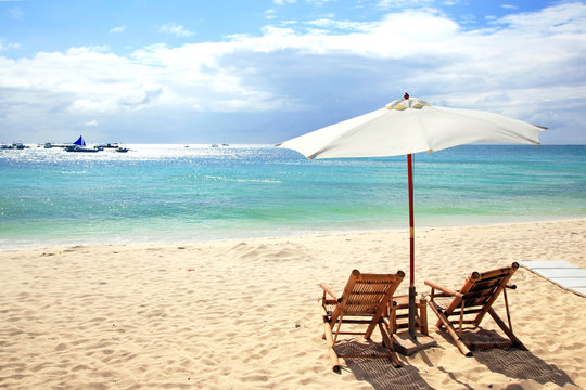 Chairs and umbrellas on a White beach, Boracay, Philippines