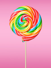 Colorful lollipop on pink background