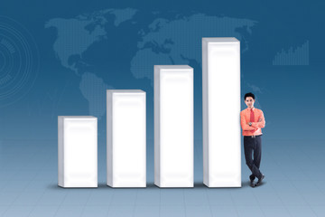 Businessman standing next to bar chart