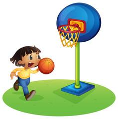 A small boy playing basketball