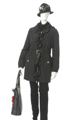 female clothing in jacket with bag on mannequin