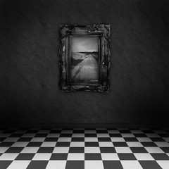 Empty dark room with black&white checker floor painting on wall