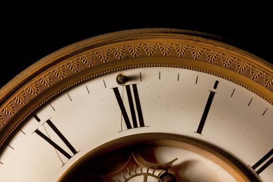 midnight strikes focus on 12 o clock on an old clock