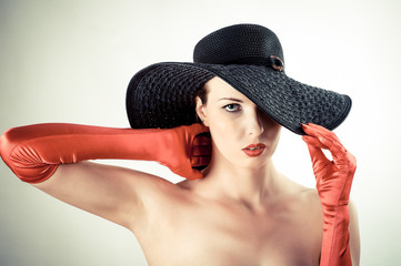 attractive woman in a hat and gloves
