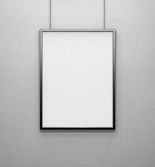 blank frame on a grey wall