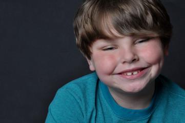 Cute young boy smiling