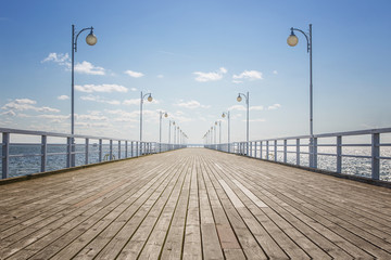Old empty wooden pier over the sea shore with copy space
