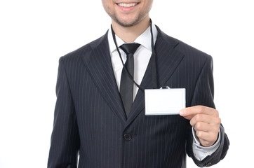 Young businessman with identification card