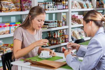 Women Having Coffee In Store