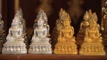 Many gold and silver small Buddha statues