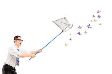 Fototapeta Man catching butterflies with net obraz