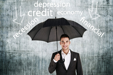 Businessman holding an umbrella protect from problems