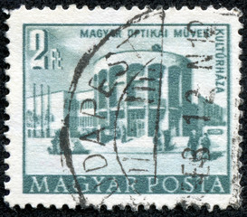 stamp printed in Hungary shows Optical works house of culture