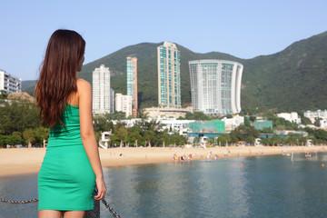 Wall Mural - Hong Kong tourist woman at Repulse Bay beach