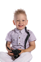 smiling boy with camera looking at camera on white
