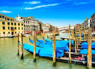 Venice grand canal, gondolas or gondole and Rialto bridge. Italy