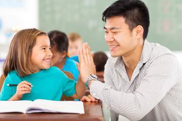elementary school teacher and student high five