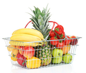 Assortment of fresh fruits and vegetables in metal basket,