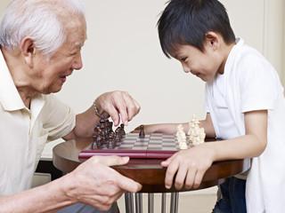 grandpa and grandson playing chess