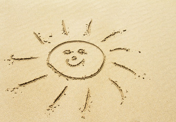 Sun drawing on golden sandy beach