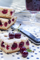 Cherry pie's bars with glass of juice and knife