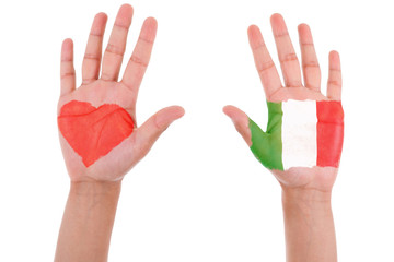 Hands with a painted heart and italian flag, i love italy concep