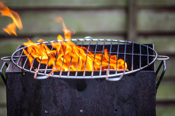 Flames grilling a steak on the BBQ