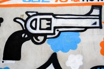 Graffiti of a pistol on a wall