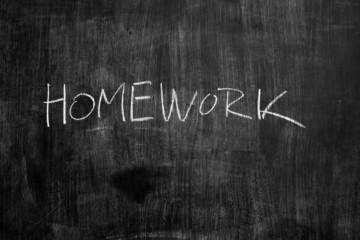 Homework written in chalk on blackboard