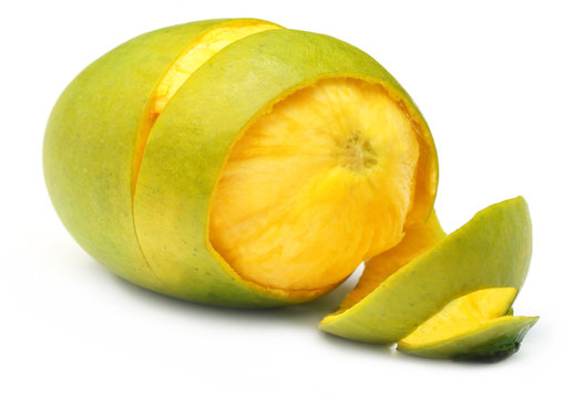 Fresh peeled mango over white background