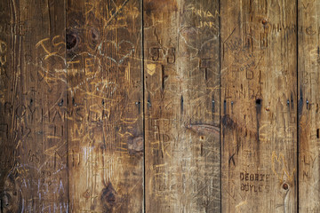 vandal graffiti on wood wall