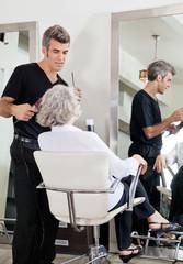 Hairdresser Attending Woman At Salon