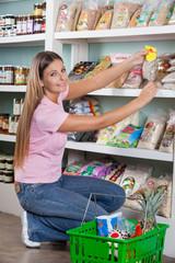 Beautiful Woman Choosing Food From Shelf