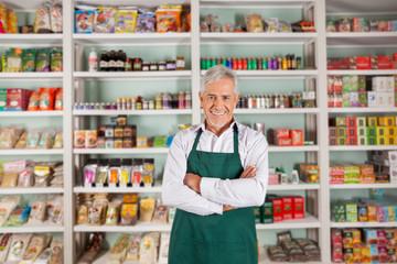 Senior Male Owner Standing In Supermarket
