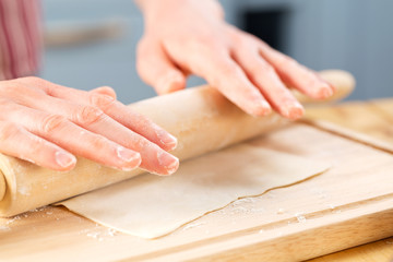 Woman rolling out dough